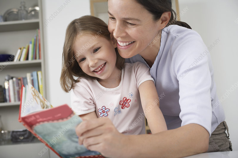 Mother and daughter reading storybook