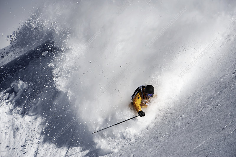 Skier speeding on hill, Austria