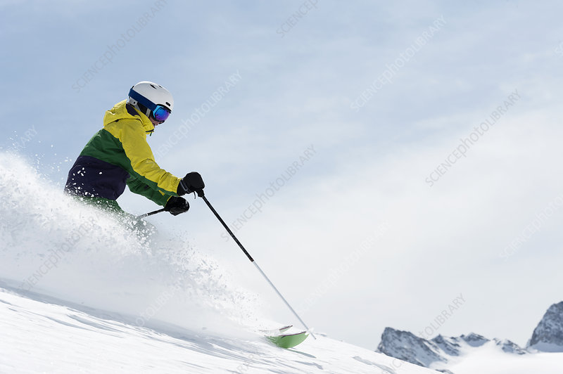 Young woman skiing downhill, Austria