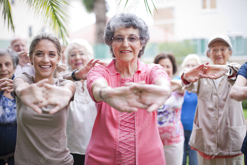 Seniors exercising in garden