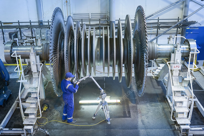 Engineer measuring steam turbine parts