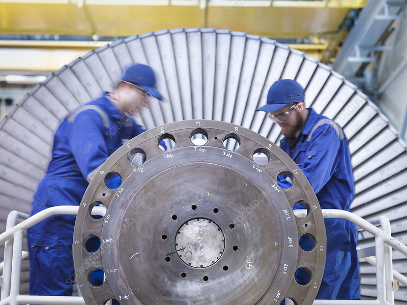 Engineers repairing steam turbine