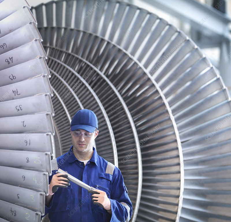 Engineer inspecting steam turbine blade