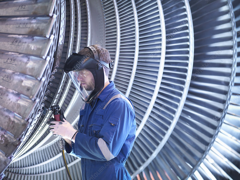 Engineer repairing steam turbine blade