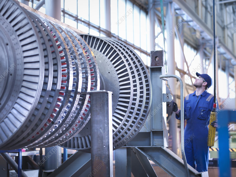 Engineer lifting steam turbine