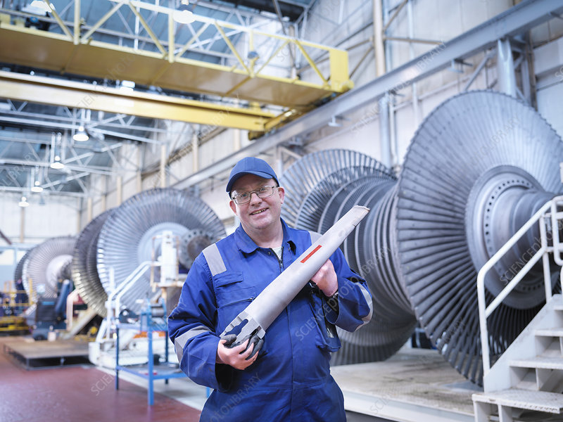 Engineer holding rotor blade
