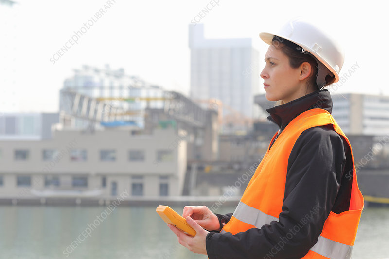 Female dockworker using monitor