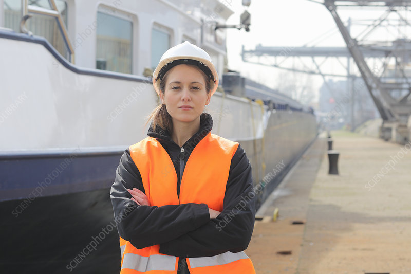 Portrait of female dockworker