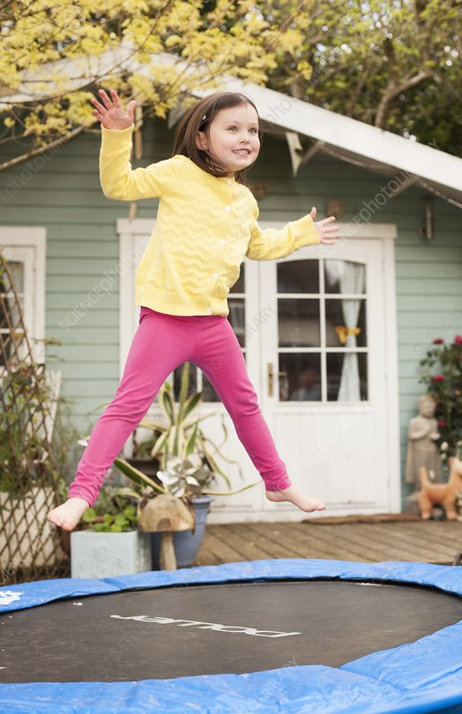 Girl bouncing on a trampoline