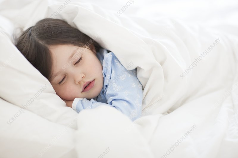 Girl asleep in bed