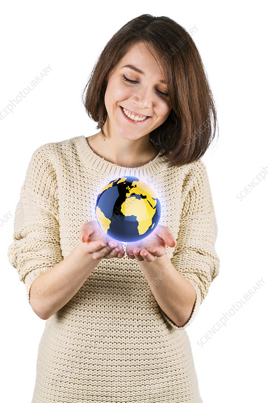 Young woman with the globe in her hands