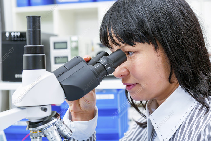 Woman using a Lab microscope