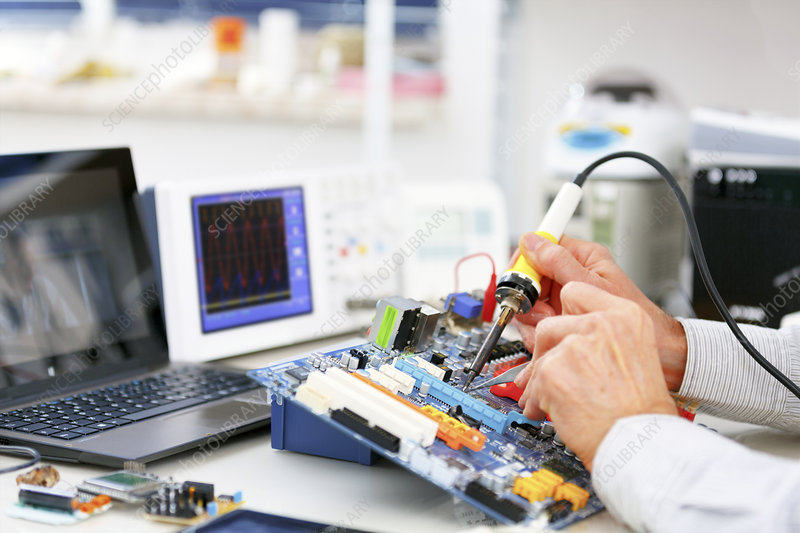 Person repairing electronic circuit board