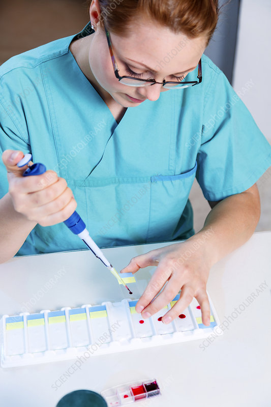Lab technician using a pipette