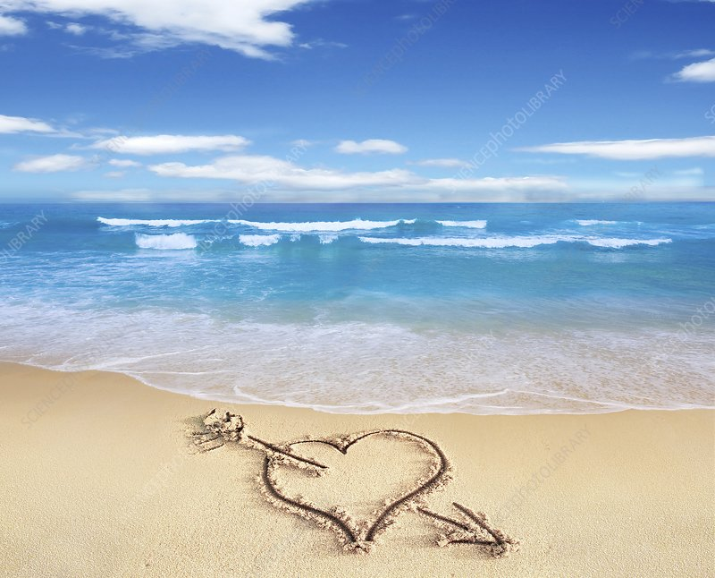 Heart shape on sandy beach, artwork