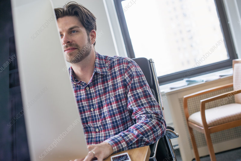A man sitting at an office desk