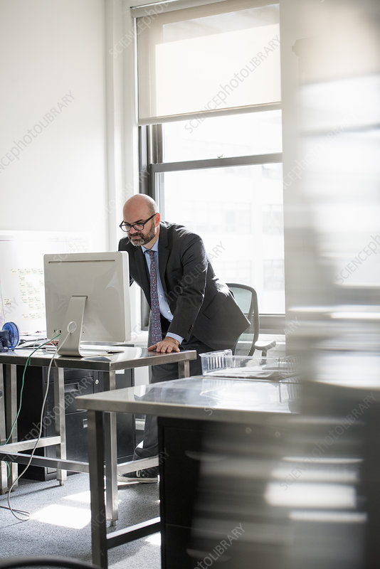 A man working alone in an office