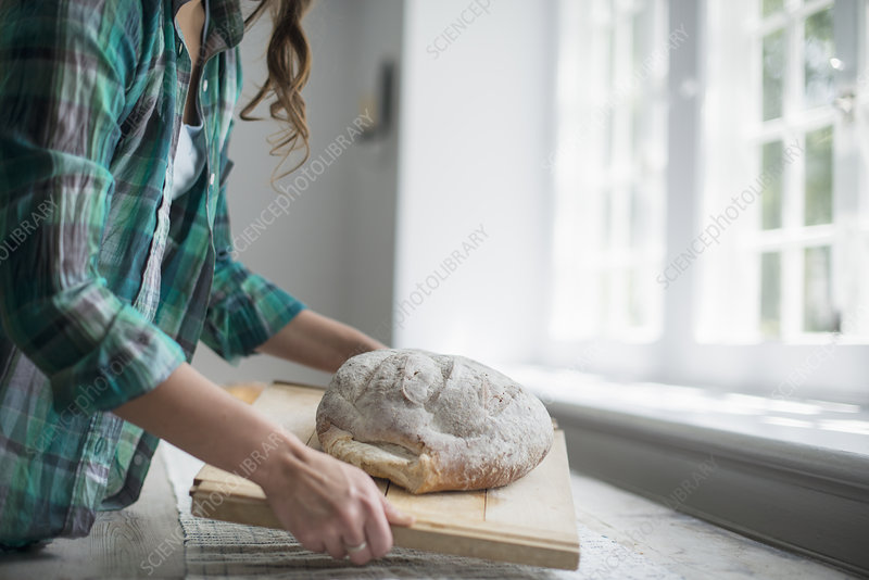 A woman with fresh baked bread