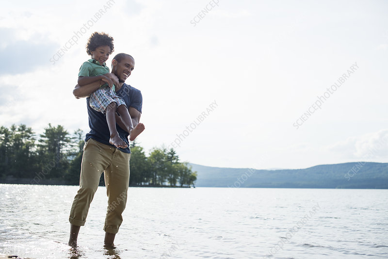 A father and son on a lake shore