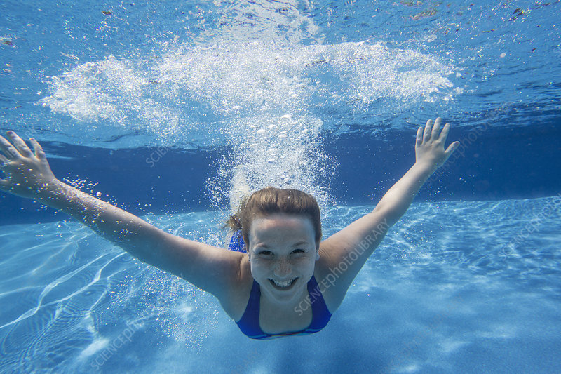 Young girl swimming underwater