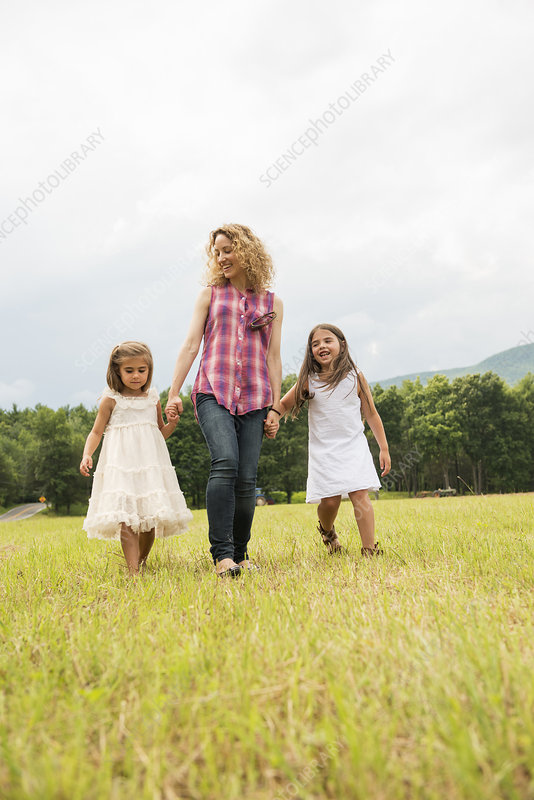 Mother playing outdoors with daughters