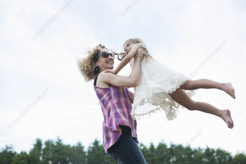 Mother playing outdoors with daughter