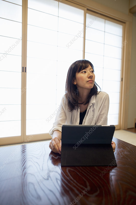 A woman with a laptop computer
