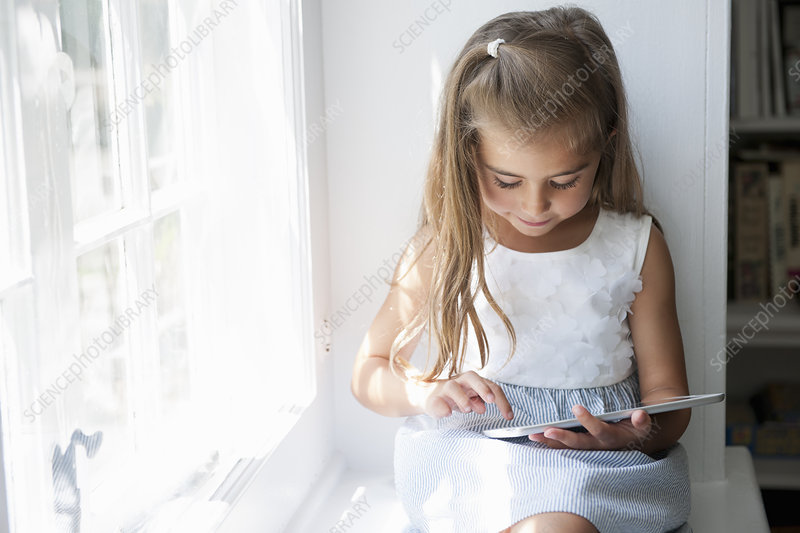 A young girl using a digital tablet
