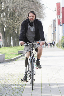 Man with prosthesis leg cycling