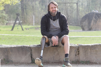 Man with prosthesis leg in park