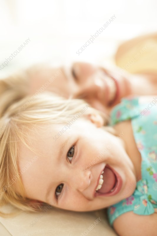 Young girl lying down laughing