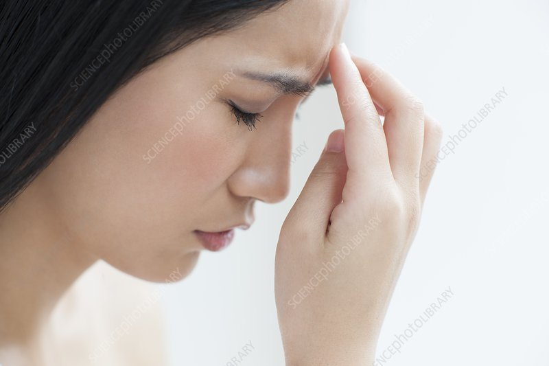 Woman touching head