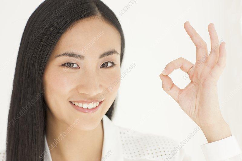 Woman making ok sign