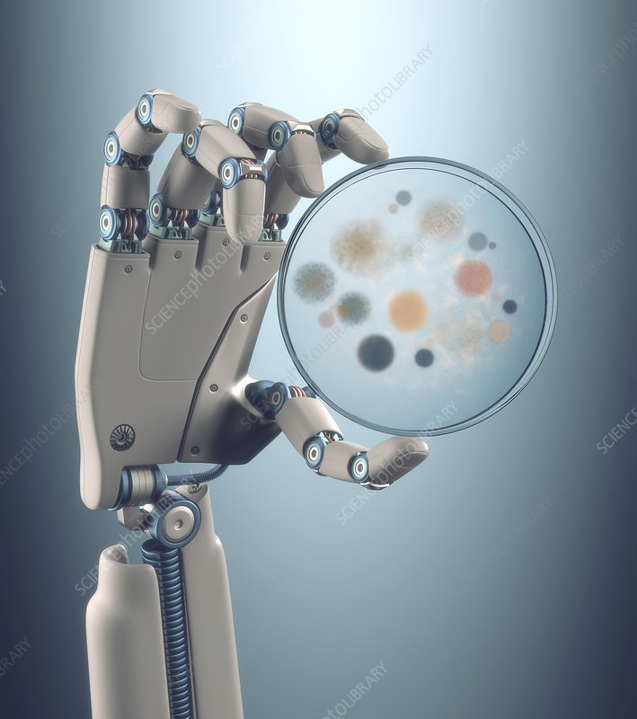 Robotic hand holding a petri dish