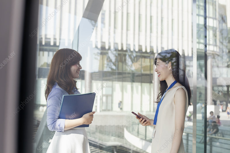 Two working women in an office building