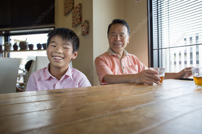 Man and boy sitting at a dining table