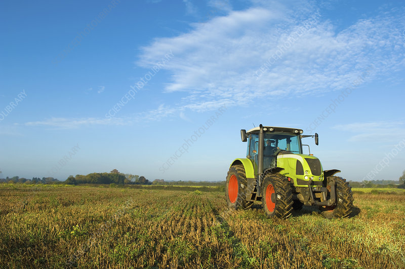 Tractor in a stubble field
