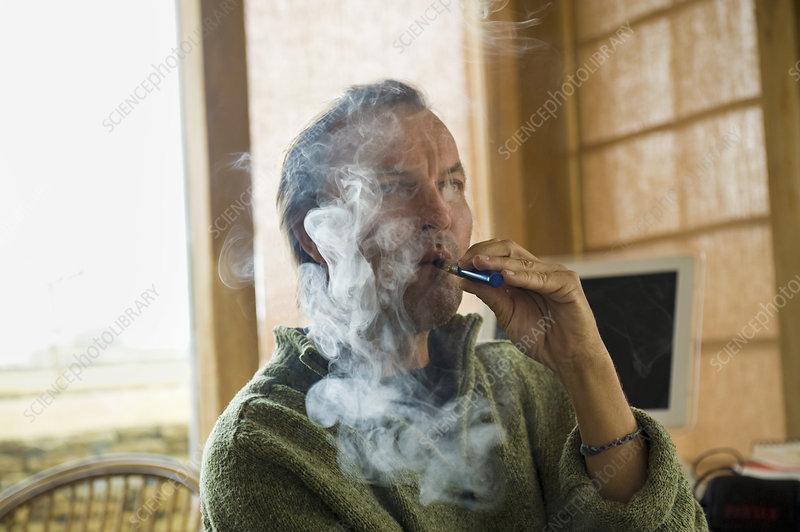 Man using electronic cigarette, vaping