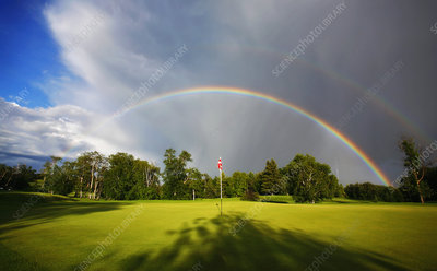 Rainbow in the sky above a golf green