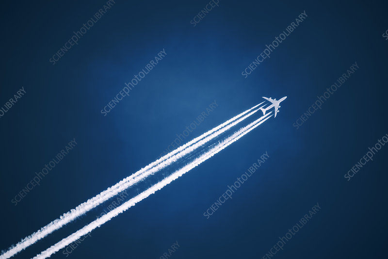 Jet vapour trail in dark blue sky