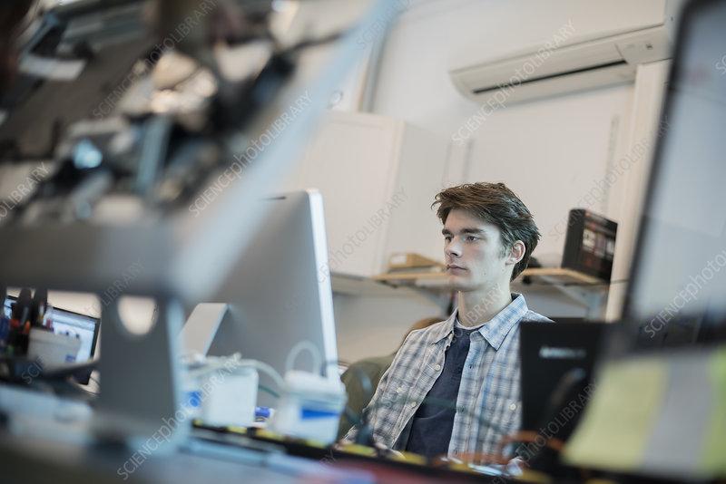 Man in a computer repair shop