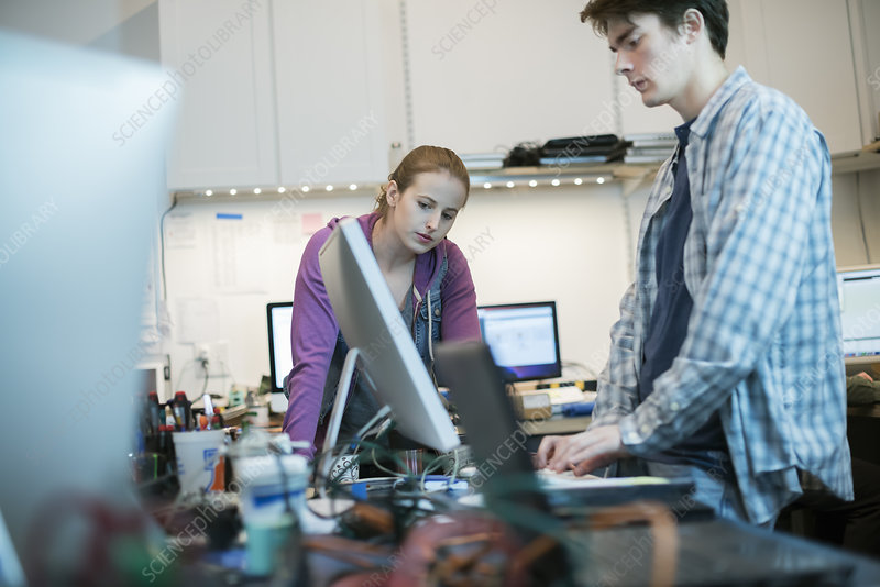 Two people in a computer repair shop