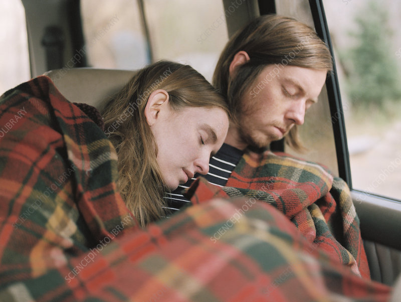 Couple taking a nap covered by a blanket