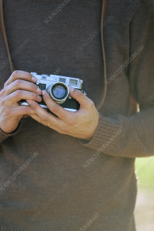 Close up of a man holding a camera