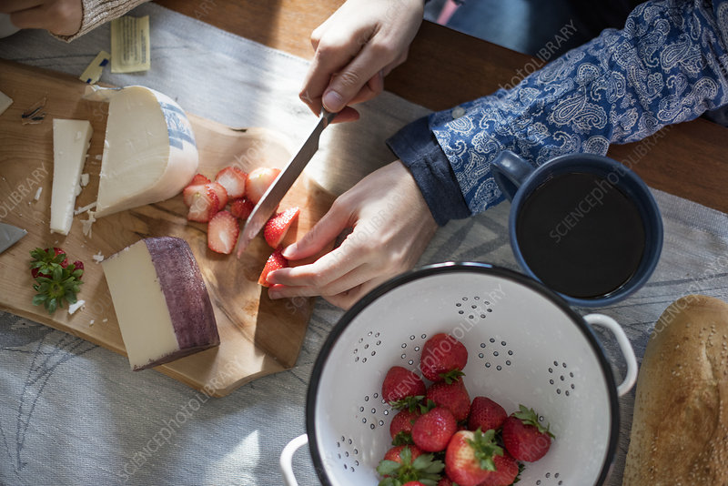 Woman slicing strawberries on a table