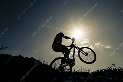 Cyclist on bike, silhouette