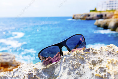 Sunglasses on the rocks by the sea