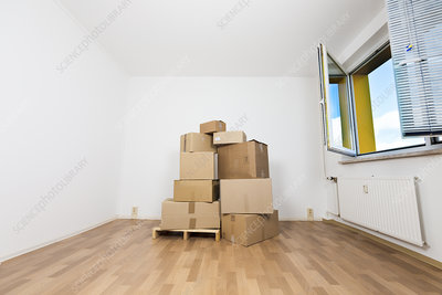 Stack of cardboard boxes in an empty room