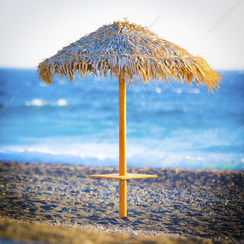 Parasol on an empty beach