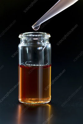 Liquid in a glass vial with a pipette
